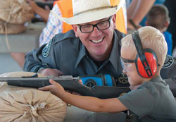 New Mexico Game & Fish officer instructs youth during a shooting sports program at Outdoor Expo.