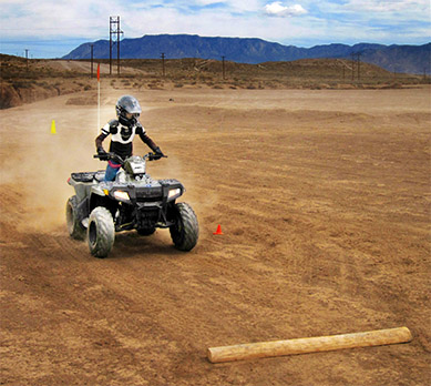 Youth riding an off-highway vehicle during free OHV safety course from New Mexico Department of Game and Fish