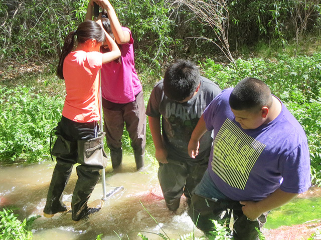 Cochiti Middle School students collecting data on water quality. Share with Wildlife, New Mexico