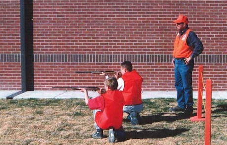 Students demonstrating the proper kneeling position during a sponsored Hunter Education Course from New Mexico Department of Game and Fish.