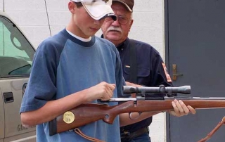 Student learns to safely work a bolt action firearm in a Department sponsored Hunter Education Course from New Mexico Department of Game and Fish.