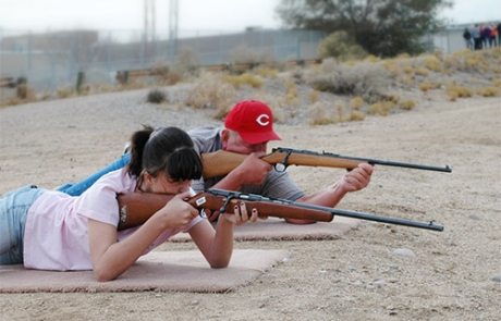 Students during New Mexico Department of Game and Fish field evaluation demonstrating the prone shooting position, the most steady of four positions.