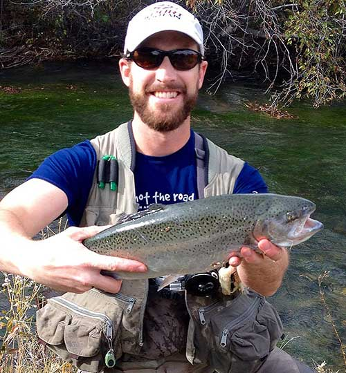 Josh Anspach Hanson, 34, of Albuquerque caught this 23-inch stocked rainbow trout in the below the Red River Fish Hatchery last fall using a Poundmeister fly.