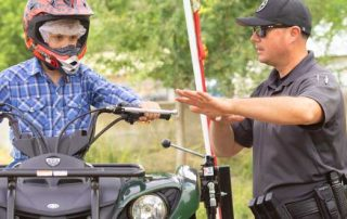 In New Mexico, many people like to recreate using an Off-Highway Vehicle (OHV). OHV Law Enforcement Coordinator Desi Ortiz shows this young man the best ways to be safe while on the trails.