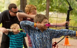 Archery can be fun and safe for all ages of youth and adults. Public Information Specialist Jeremy Lane coaches this group of youth as they shoot archery for the first time.