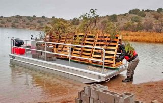 Three pisces pyramids loaded on barge.
