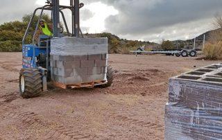 Cinderblocks being delivered.