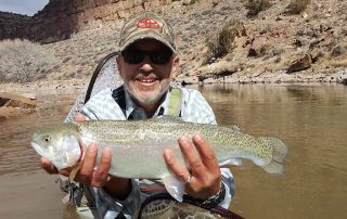 Carlos Vigil with big rainbow caught in improved habitat reach
