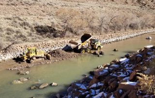 Contractor constructing gravel point bar and low flow channel